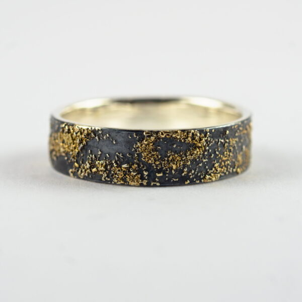 Gold Chaos - 6 mm. The ring is made from sterling silver, slightly textured with reticulation and oxidized. Gold spots are solid 18kt gold. It is random mix of gold dust, microgranules and solder fused to silver surface.