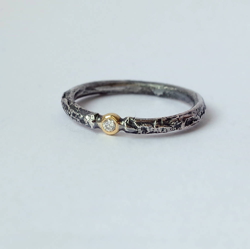 Rustic Diamond 18k Yellow Gold: Sterling silver band textured with reticulation (melting of the surface), round and comfortable, 2mm wide. Gemstone setting is made from 18k Yellow gold. Diamond is 1.5 mm, SI quality, near colorless (G/H) and conflict free. Set in neat gold ball.