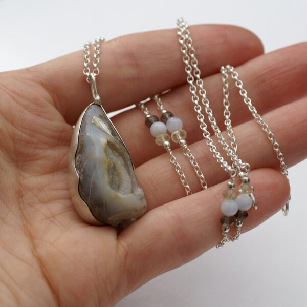 Sea Druzy: Sterling silver necklace with fossilized shell druzy. Adorned with blue lace agate, smoky quartz and lemon quartz beads.