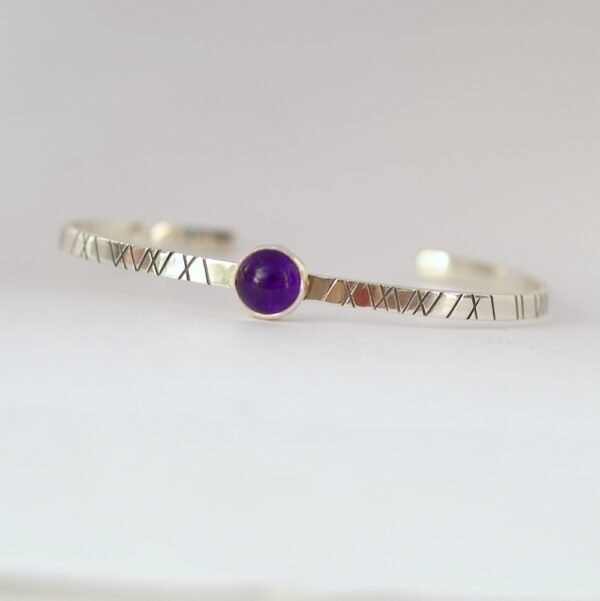 Amethyst Cuff Bracelet: Sterling silver textured bracelet with amethyst cabochon.