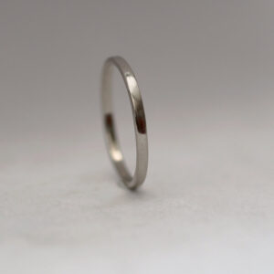 Dainty Palladium: The ring is made from flattened 1.5mm round wire, hand forged to flat shape with rounded edges. All hammer marks are then smoothened and ring is polished to shiny finish.