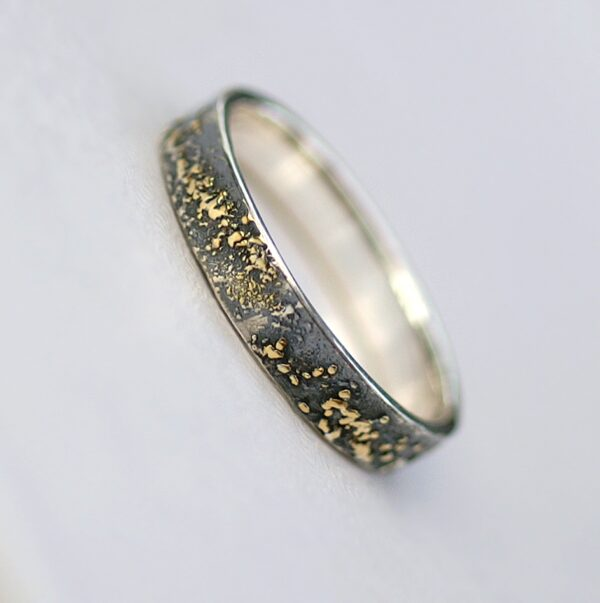 Gold Chaos - 4 mm. The ring is made from sterling silver, slightly textured with reticulation and oxidized. Gold spots are solid 18kt gold. It is random mix of gold dust, microgranules and solder fused to silver surface.