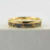 Gold Chaos with Gold Edge: The ring is made from sterling silver, slightly textured with reticulation and oxidized. Gold spots are solid 18kt gold. It is random mix of gold dust, microgranules and solder fused to silver surface. The edge is solid 18k gold.