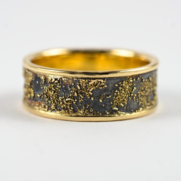 Gold Chaos Luxury: Distinctive and luxurious wedding band featuring contrast of rich yellow gold and oxidized silver.