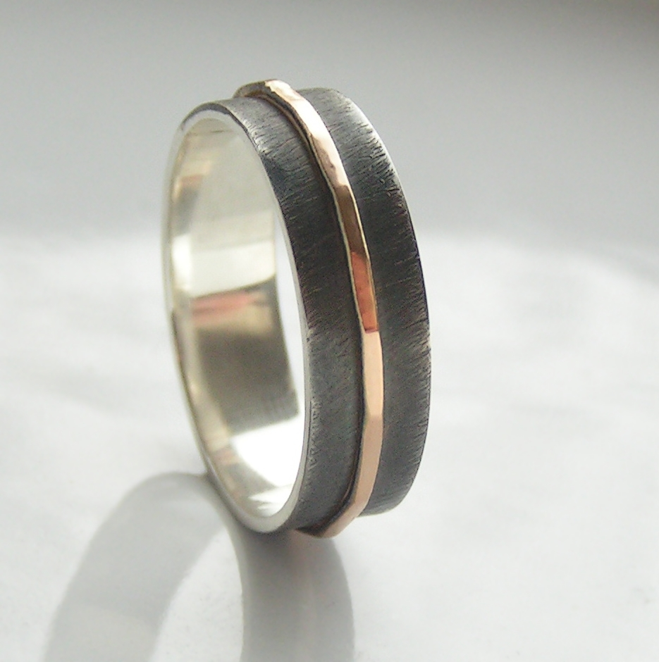 Textured - 6 mm Rose Gold: The main part of the ring is made of sterling silver, textured, oxidized and slightly polished. Central rose gold part is hammered and polished. Inside of the ring is also polished for contrast.