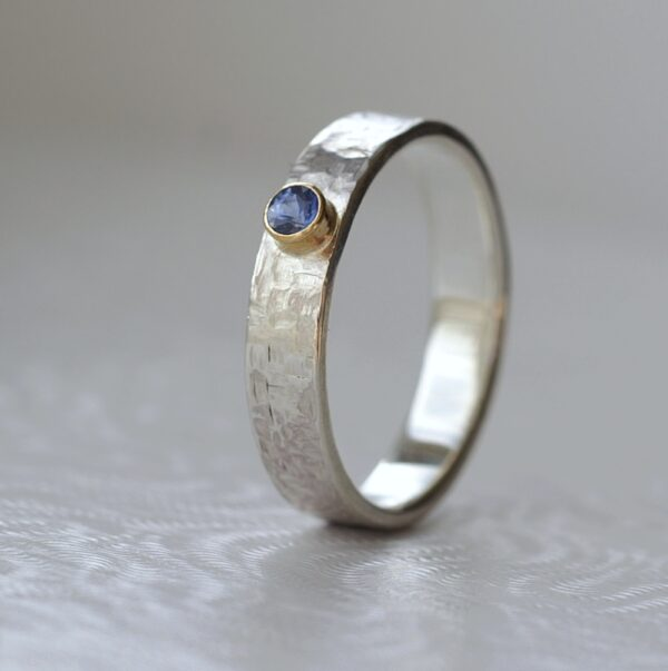 Blue Sapphire Engagement Ring: Sterling silver and 18k gold unique engagement ring or gemstone wedding band. Adorned with natural blue sapphire from Sri Lanka.