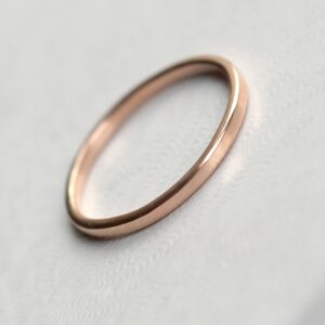 Dainty Rose Gold Wedding Band: Simple dainty rose gold wedding ring. Thin, lightweight and versatile, easy to combine with engagement ring.