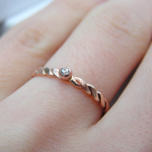 Dainty White Sapphire Rose Gold Ring: Simple, elegant, comfortable to wear and affordable ring made from twisted rose gold wire. Gemstone is high quality white sapphire, 1.5 mm in diameter. It is set in simple bead-shaped setting.