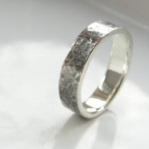 Rock Texture Ring: Unisex ring or men's band decorated with rock resembling hammered texture.