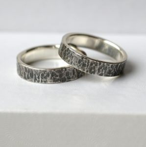 Rock Texture Rings Set: A set of sterling silver wedding bands with unique hammered texture.