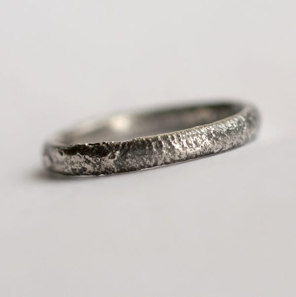Rustic Oval Wedding band: This ring is made with oval shaped wire textured with reticulation technique. It is done with many rounds of high heat treatment resulting in melting of silver surface only.