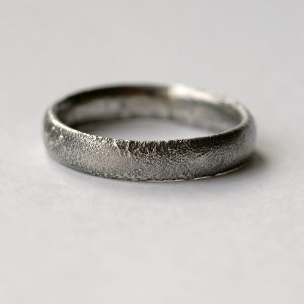Rustic Oval Men's Wedding band: This ring is made with oval shaped wire textured with reticulation technique. It is done with many rounds of high heat treatment resulting in melting of silver surface only.