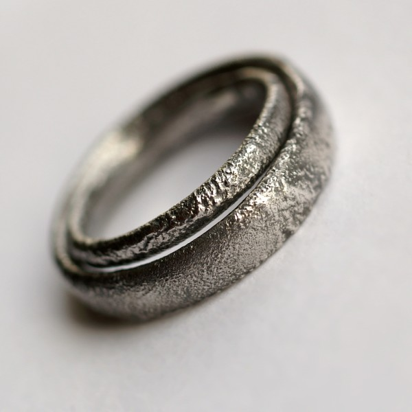 Rustic Oval Wedding Bands Set: These ring are made with oval shaped wire textured with reticulation technique. It is done with many rounds of high heat treatment resulting in melting of silver surface only.