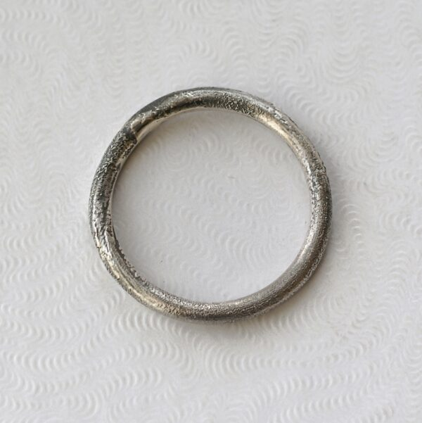 Rustic: Sterling silver band textured with reticulation (melting of the surface), round and comfortable, 2mm wide.