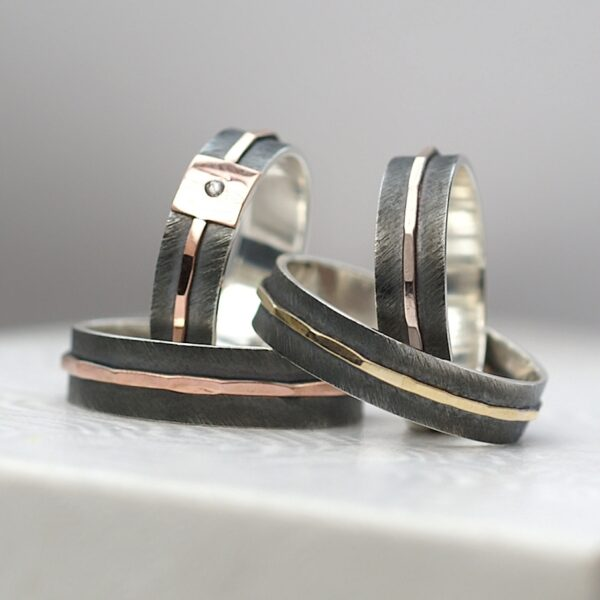 Textured Collection: These rings are made of sterling silver. Main part is textured, oxidized and slightly polished, middle part is hammered and polished to shine. Inside of the ring is also shiny.