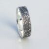 Silver Chaos - Oxidized Finish: Sterling silver wedding band with unique rustic texture. The texture is done by layering and fusing silver dust and micro pieces onto the heat treated surface of the ring.