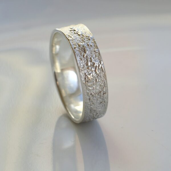 Silver Chaos - Shiny Finish: Sterling silver wedding band with unique rustic texture. The texture is done by layering and fusing silver dust and micro pieces onto the heat treated surface of the ring.