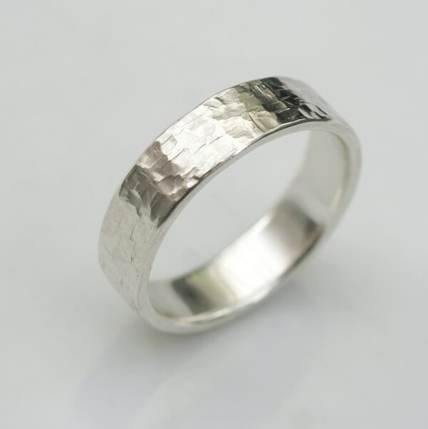 Rock Texture 9k White Gold Ring: Simple hammered wedding band made of 9k white gold.