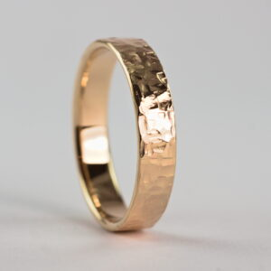 Rock Texture 9k Yellow Gold Ring: Simple hammered wedding band made of 9k yellow gold. The texture is made with my customized hammer so it is absolutely unique and it is not possible to make the same ring without that hammer.