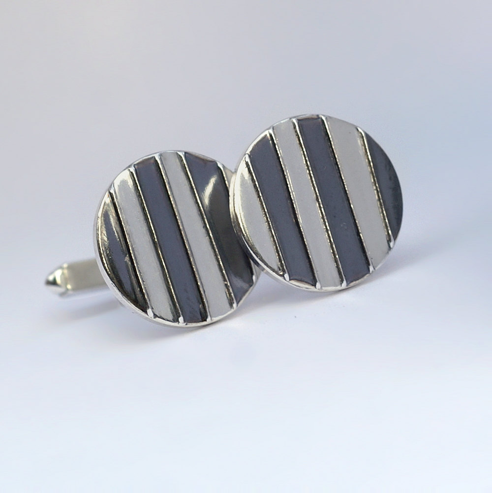 Striped Cufflinks: The stripes are oxidized and lightly polished to shiny black finish, the rest of the cufflinks is highly polished
