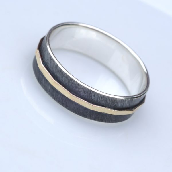 Textured - 6 mm Yellow Gold: The main part of the ring is made of sterling silver, textured, oxidized and slightly polished. Central yellow gold part is hammered and polished. Inside of the ring is also polished for contrast.
