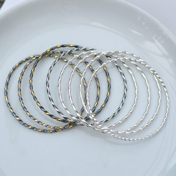 Twisted Silver Bracelets Mix: A mix of Simple twisted bangle bracelets.