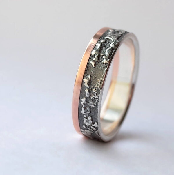 Silver Chaos with Rose Gold Edge - Sterling silver wedding band with unique rustic texture and rose gold edge.