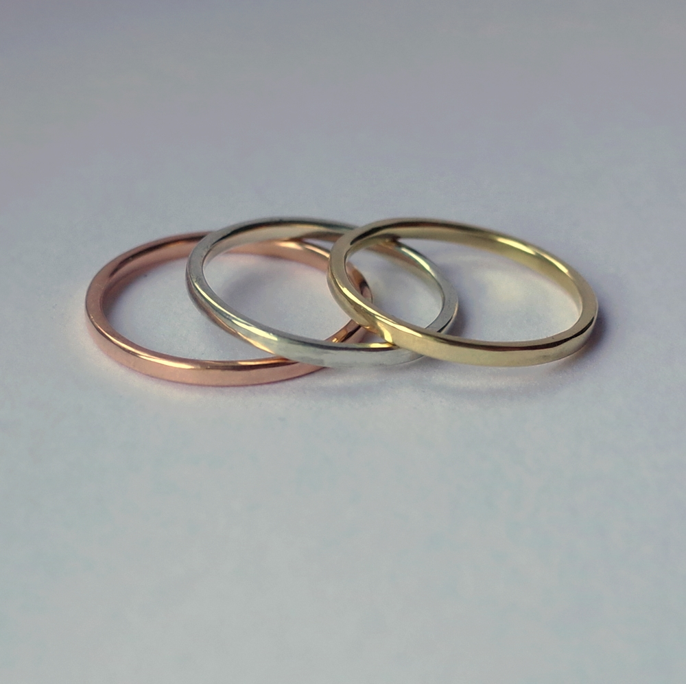 Dainty Wedding Bands Collection - A collection of white 18k, rose 9k and white 9k gold simple dainty wedding bands in shiny finish.