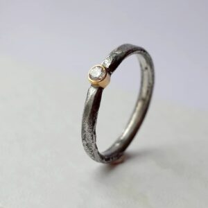 Rustic Diamond 3mm - sterling silver textured band with 3 mm diamond in 18k gold setting.