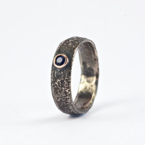 Black Sapphire Men's Engagement Ring - Rustic silver ring with black sapphire in a rose gold setting.