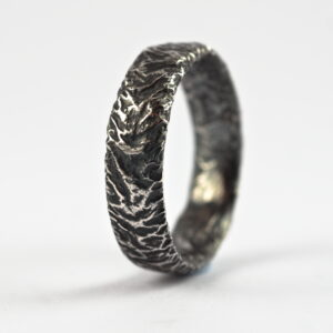 Rustic Wide Men's Wedding Band: This ring is made with oval shaped wire textured with reticulation technique. It is done with many rounds of high heat treatment resulting in melting of silver surface only.