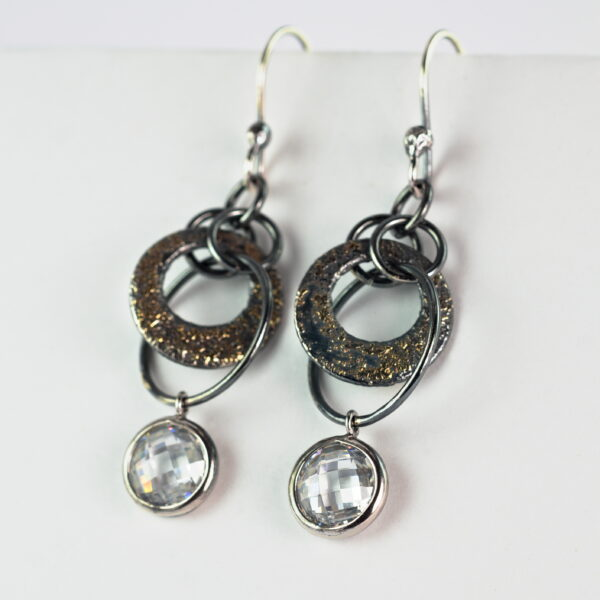 Oxidized sterling silver and 18k yellow gold cubic zirconia earrings.
