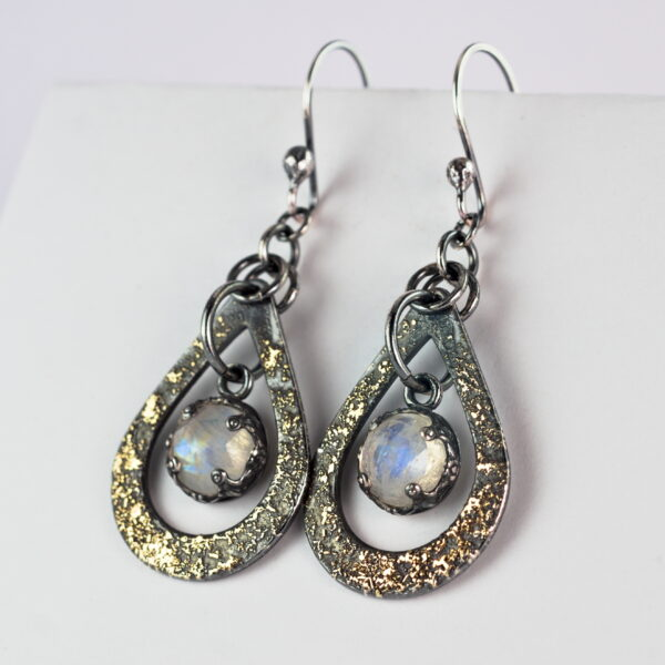 Oxidized sterling silver and 18k yellow gold moonstone earrings.